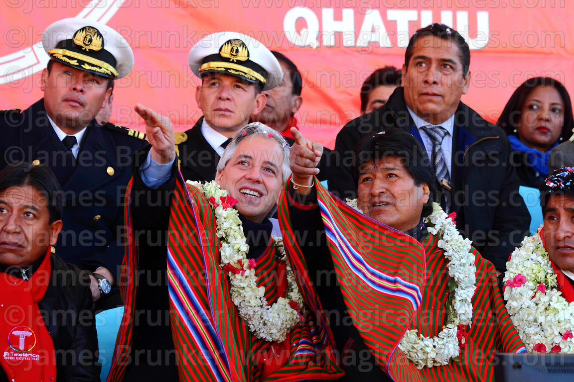 Bolivian president Evo Morales (right) and vice president Alvaro Garcia Linera (centre) gesture towards the cable car cabins ...