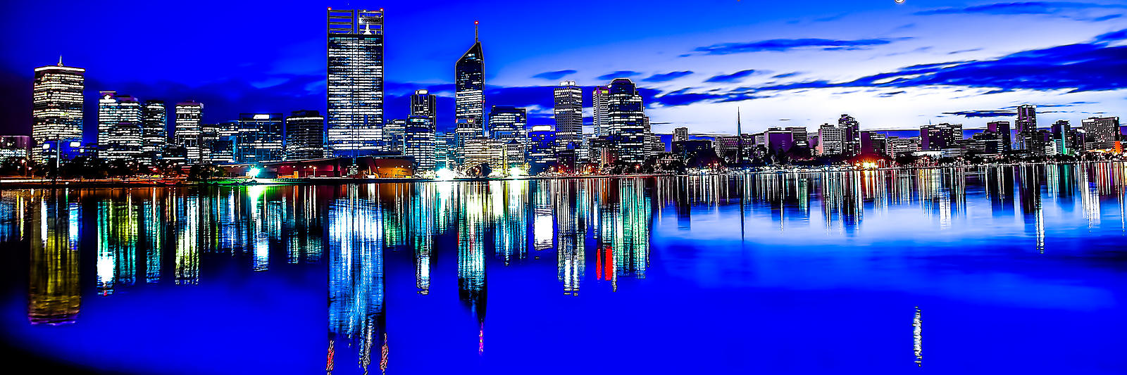 Perth cbd at night reflecting in the swan river