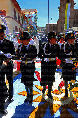 Policewomen clear the way for the main procession of the Virgen de la Candelaria through Plaza de Armas, Puno, Peru