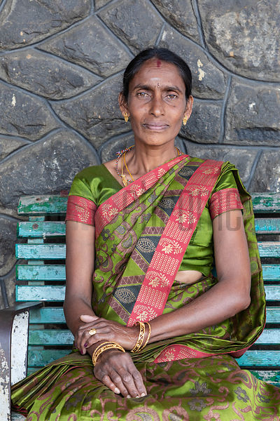 Portrait of a Woman in a Sari Waiting for a Train