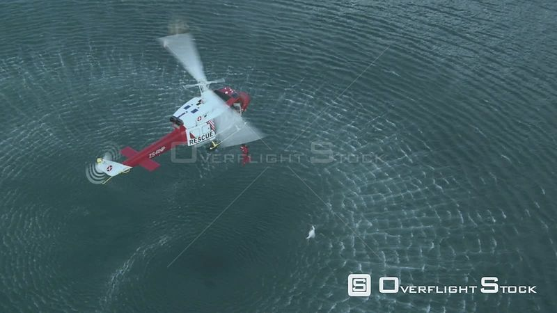 Aerial of a man jumping from a rescue helicopter into the sea Cape Town Western Cape South Africa