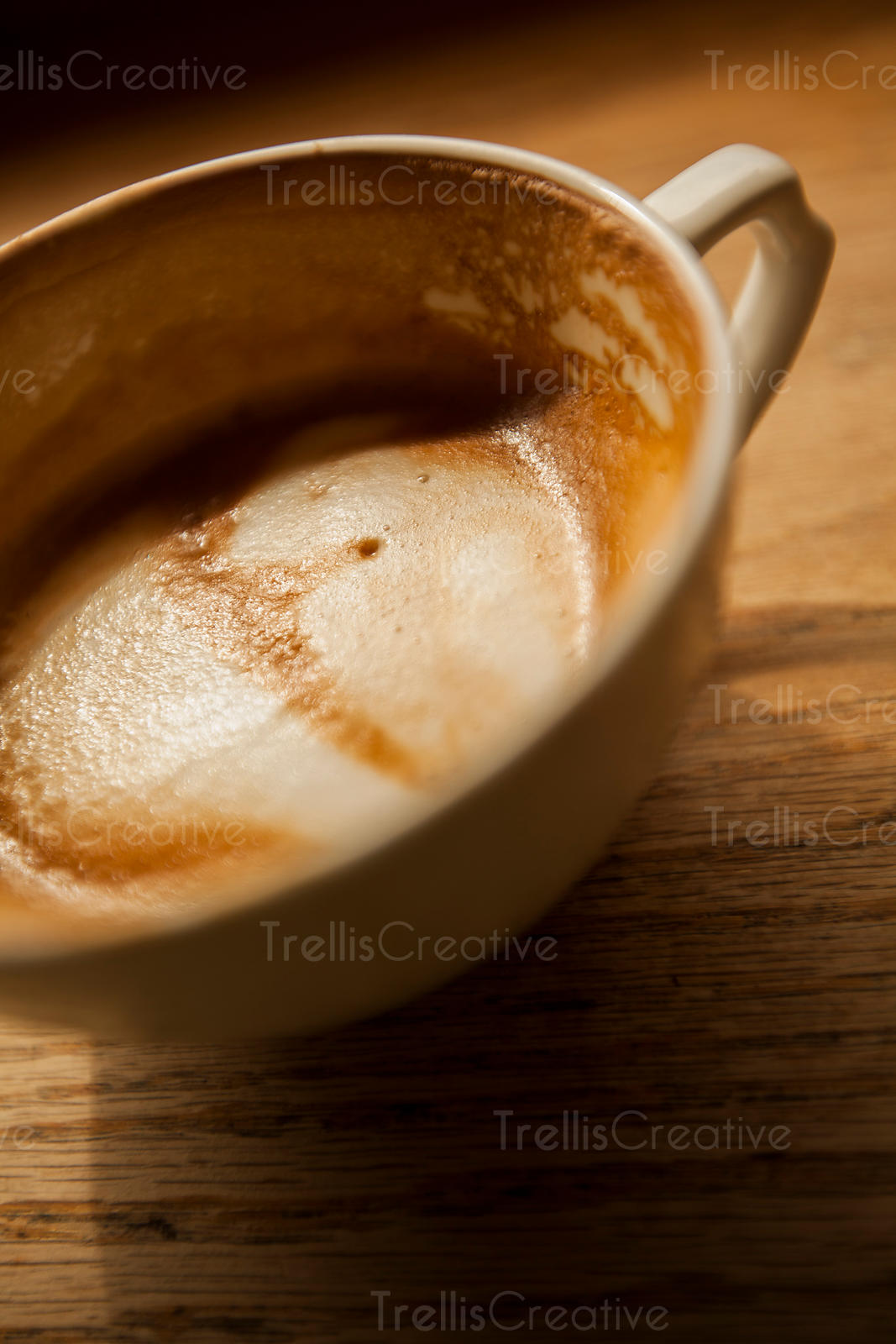 A cup of foamy cappuccino coffee