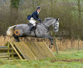 Rebecca Collie jumping a hunt jump at Peakes - The Fitzwilliam Hunt visit the Cottesmore at Burrough House