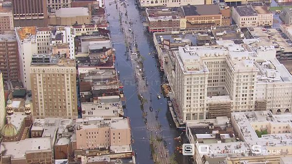 Aerial Shots zoom in New Orleans after Hurricane Katrina Survivors in Flooded Streets.