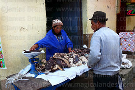 Man buying charqui (dried meat, usually beef or llama) in street market, Coroico, Bolivia
