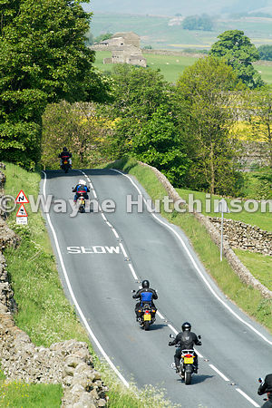 Motorbikes on a rural road in Wensleydale, North Yorkshire, UK.