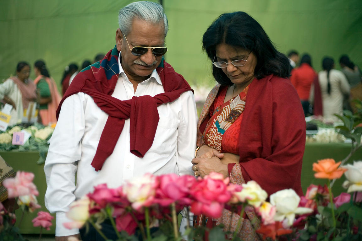 India - Delhi - A couple inspect plants judged in a competition at the Annual Garden Festival at the Garden of the Five Senses