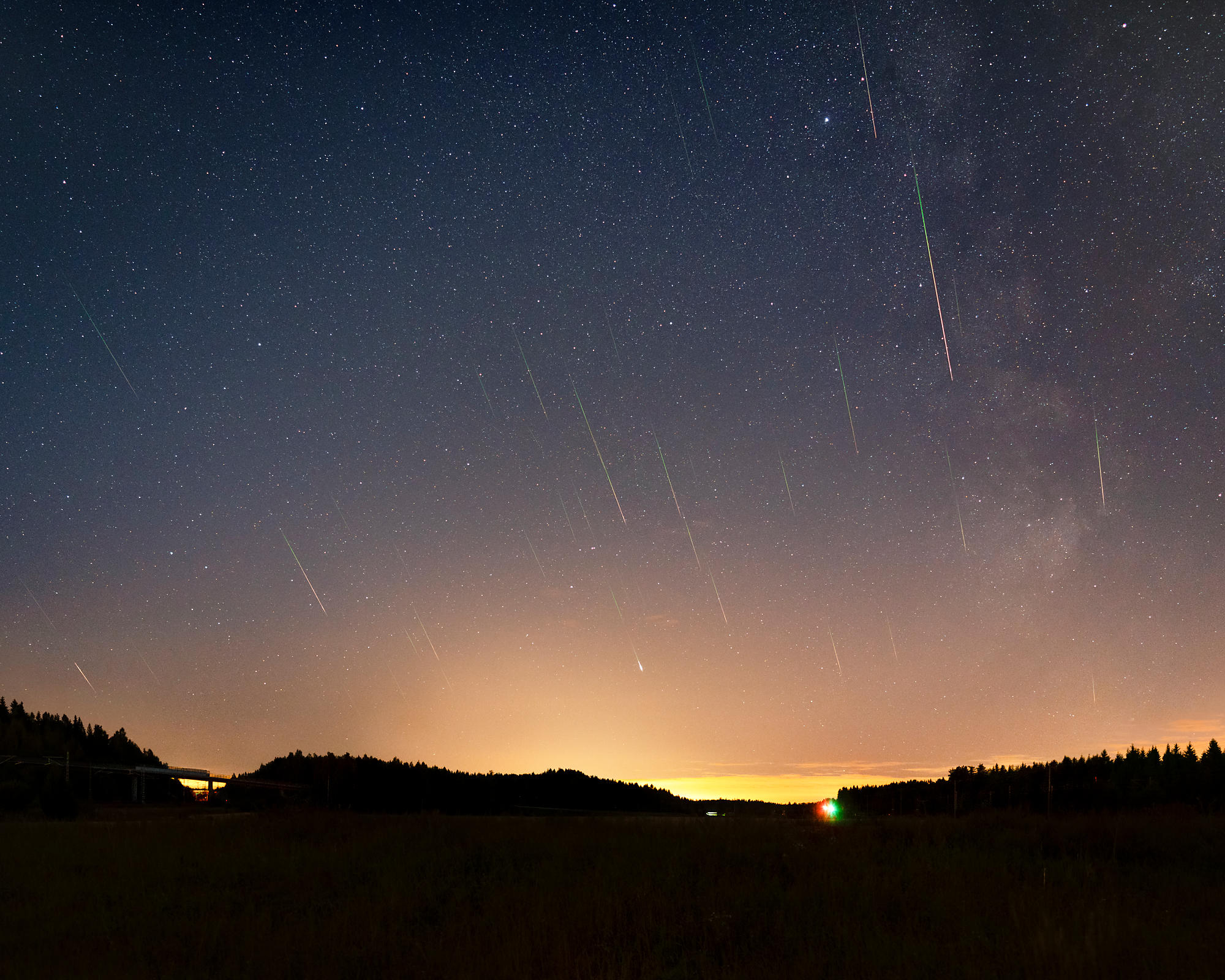 40 Perseids above the landscape in Southern Finland on August 14 2018. Composite image photographed between 01.17 and 02.06. ...