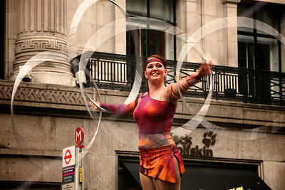 Young Woman Performing with Hoops on Stage in a Central London Street