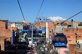 Blue Line cable car cabin with Mar para Bolivia / Sea for Bolivia slogan on it and Av Chacaltaya station, Mt Illimani in back...