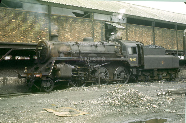 Standard 4MT Class No 76025 simmers beside the coaling plant at Eastleigh mpd awaiting its next duties  c. 06/1964