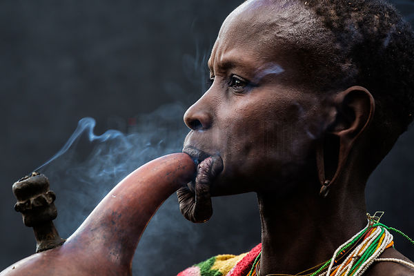 Portrait of a Surma Woman Smoking a Pipe