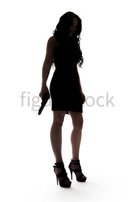A Figurestock image of a woman, standing, holding a gun, in silhouette – shot from low level.