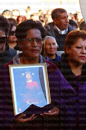 A member of the brotherhood of Señor de las Caidas / The Fallen Christ carries a picture of Jesus during Good Friday processi...