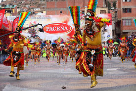 Masked warriors dancing the tobas, Oruro Carnival, Bolivia