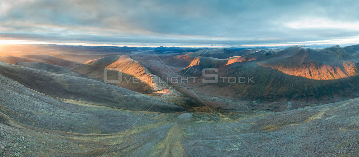 Carn a' Mhaim, Stob Coire an t-Saighdeir and the Devil's Point in morning light, with source of River Dee cutting through the...