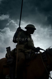 An atmospheric image of a British soldier on horseback in WW1.