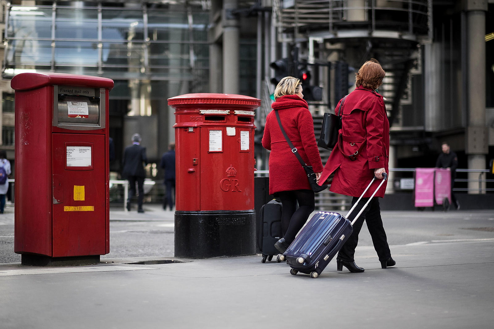 Two-women-wearing-red-coats-walking-past-two-red-letterboxes-Copyright-Rob-JOHNS_20170313_ROB7948