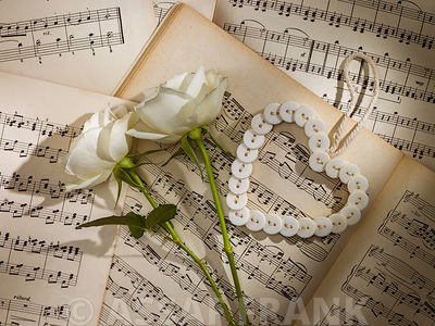White Roses with heart on music sheets