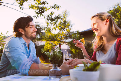 Couple having dinner in garden