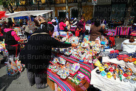 Woman shopping at stall selling ekekos and other miniatures, Alasitas festival, La Paz, Bolivia