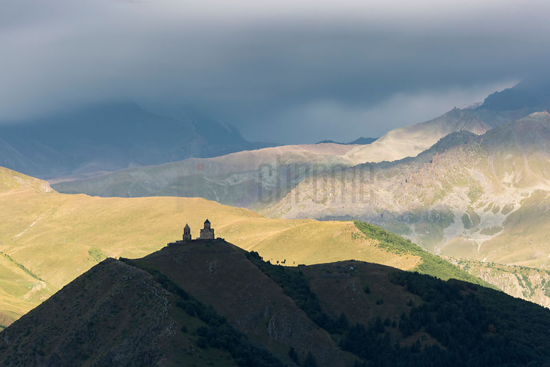 View Towards Kazbegi Mountain and the Gergeti Trinity Church at Sunrise