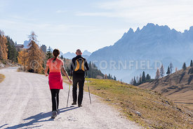 A man and woman hiking in the Fanes Sennes Prags Nature Park near Schluderbach Carbonin in the South Tyrol, Italy.