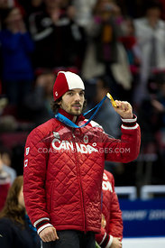 Feb 26, 2010: Pacific Coliseum, Vancouver, BC. Charles Hamelin of Canada wins the Gold Medal in the Mens 500m sprint event in...