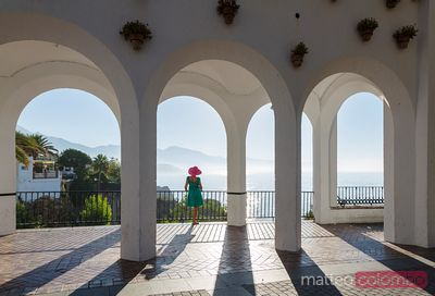 Tourist looking at sea from Balcon de Europa, Nerja, Spain