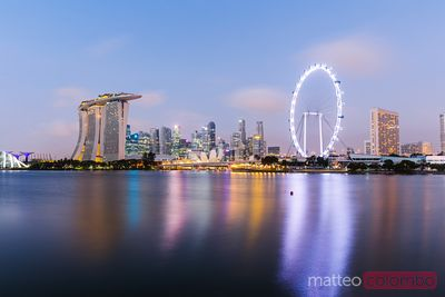 Singapore skyline at night reflected in lake, Singapore