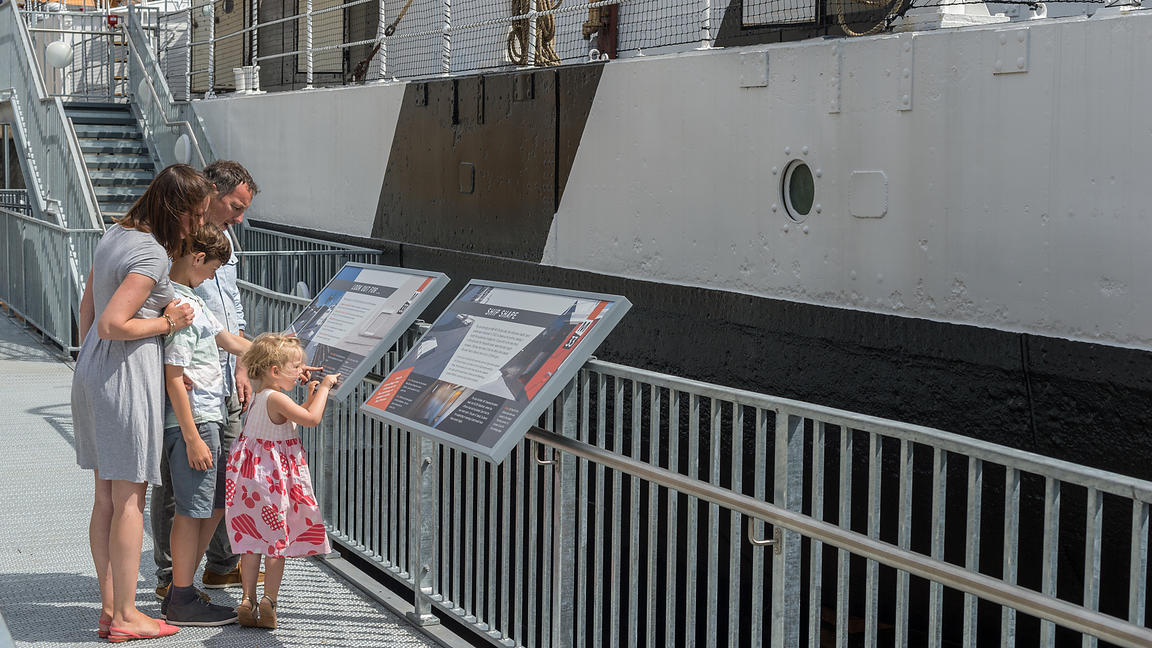 Visitors to M33  Battleship in Portsmouth Historic Dockyard