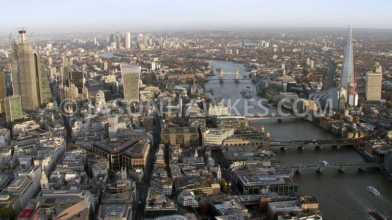 Aerial footage of the City of London, Cannon St, Monument, River Thames, 20 Fenchurch St, The Shard, London.