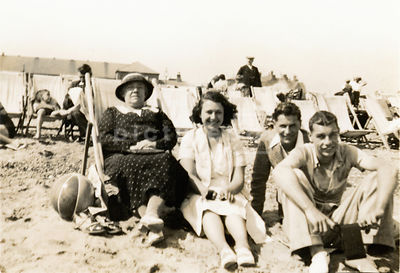 NOT FOR MISERY MEMOIR USAGE - An old family photograph of a family outing to a seaside beach.