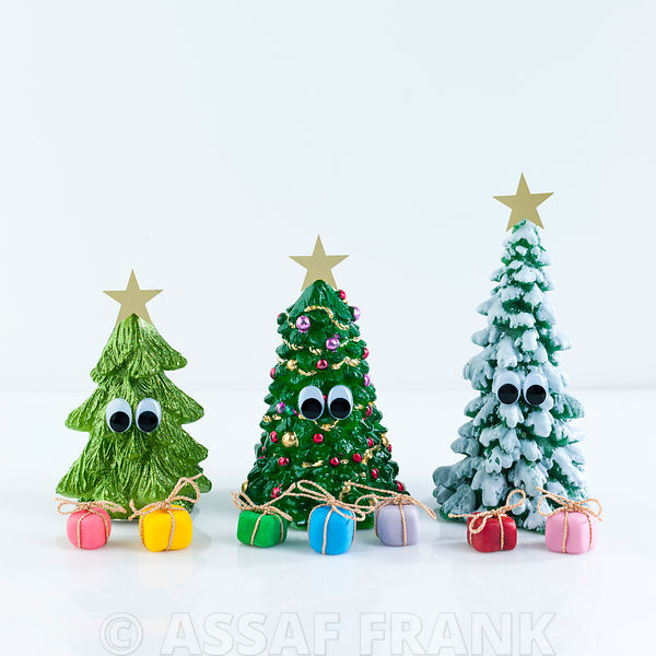 Decorated Christmas trees with gift boxes on white background