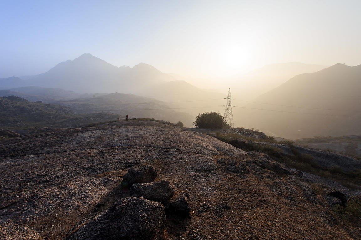 Foggy morning in the rocky foothills of the Aravali Range above the 7th century Ajaypal Shiva temple, Rajasthan, India