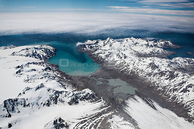 Aerial view of Fortuna Bay and Konig Glacier with clouds over the sea, South Georgia, Antarctica, December 2006
