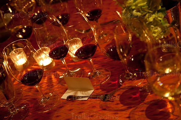 Red wine glasses on table with candle light