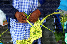 Detail of lady making ornaments out of palm leaves on Palm Sunday, La Paz, Bolivia