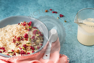 Quinoa Porridge with Raspberries and Nuts.