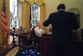 Sandy Burger talks with President William Clinton in the Oval Office.