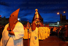 Penitents carrying statue of Virgen de los Dolores / Virgin of Sorrows during Good Friday procession, La Paz, Bolivia