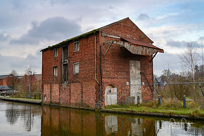 Dilapidated canal wharf building in Ellesmere.