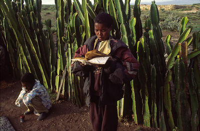 An Ethiopian child reads his Koran at dawn