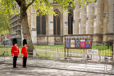 Two Guardsmen stand outside Westminster Abbey