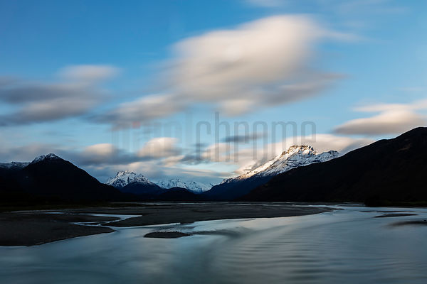 Clouds Moving at Dusk at the Dart River near Glenorchy/Queenstown - Central Otago, New Zealand .