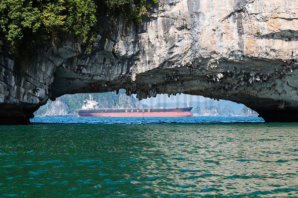 Cargo Vessel in Halong Bay seen through Cave