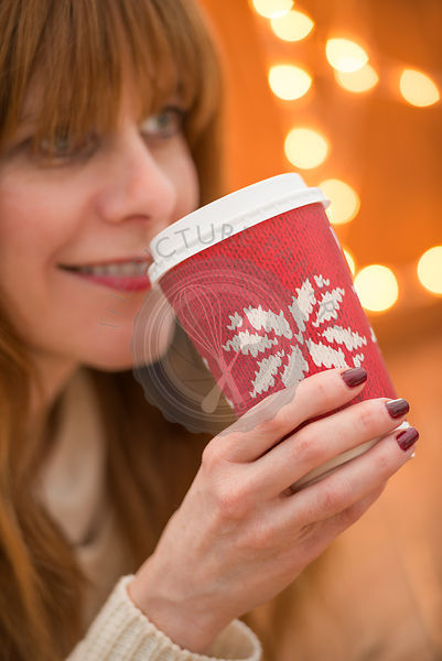 Woman drinking a festive drink at Christmas time