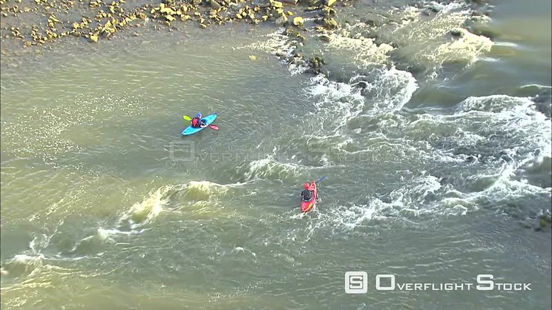 Orbiting kayaks on a gravel bar along the Meuse (Maas) River, Belgium