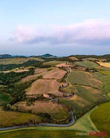Aerial view of winding road at sunset, Tuscany, Italy