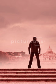 An atmospheric image of a mystery men standing on some steps in Rome, Italy.
